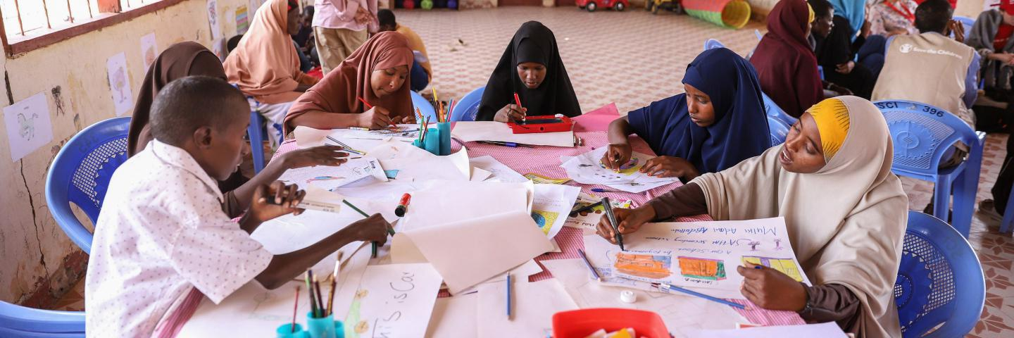 Children doing art work in a schoolSave the Children supports in Daadab