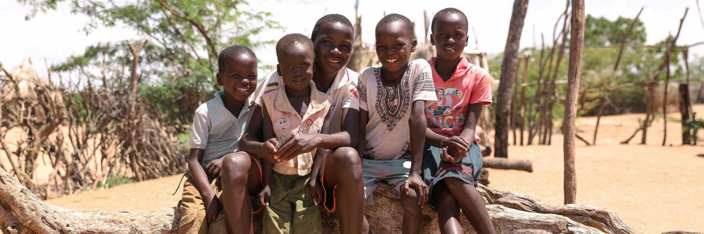 Matthew, 13, sits with his brothers and sisters in their village in Turkana, northwestern Kenya