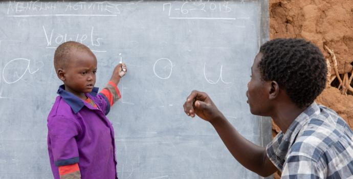 ECD teacher Simon with Jackson during a class in the outskirts of Lodwar.