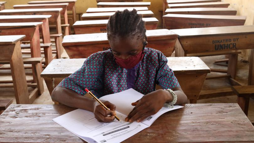 An adolescent girl studying in a classroom