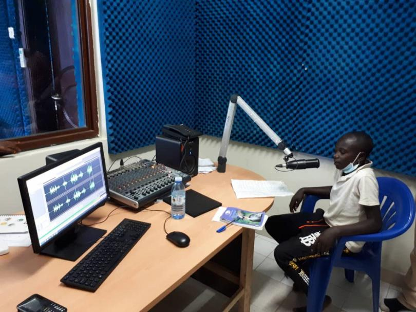Children on the radio in western Uganda to talk about Covid-19