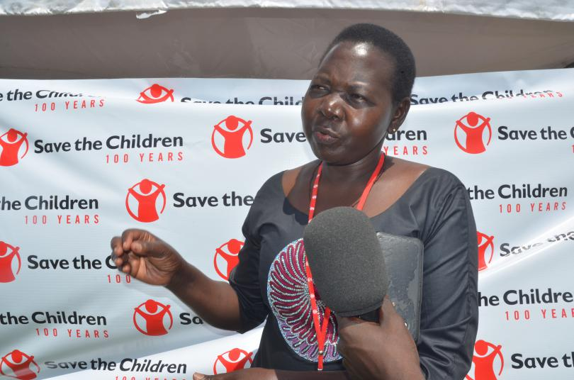 Save the Children's Regional Area Manager Coreen Auma speaks to the media about child marriage. Immaculate Nalubyayi / Save the Children