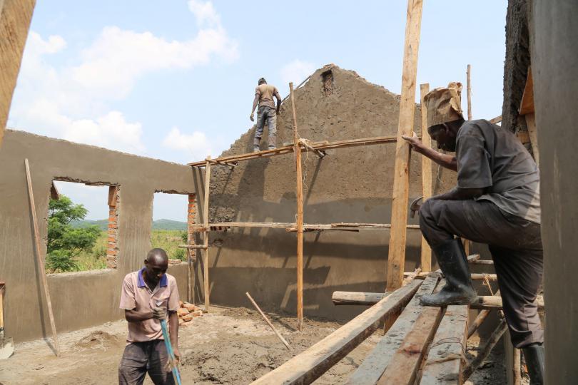 Constructing new classrooms in Rwamwanja refugee settlement. Alun McDonald / Save the Children
