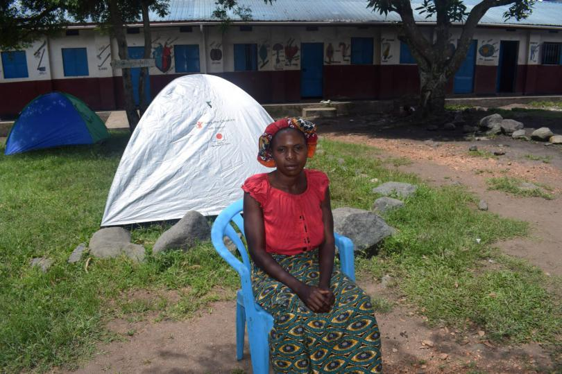 Joseline outside her tent at an IDP site at a local school. Stella Nassolo /Save the Children