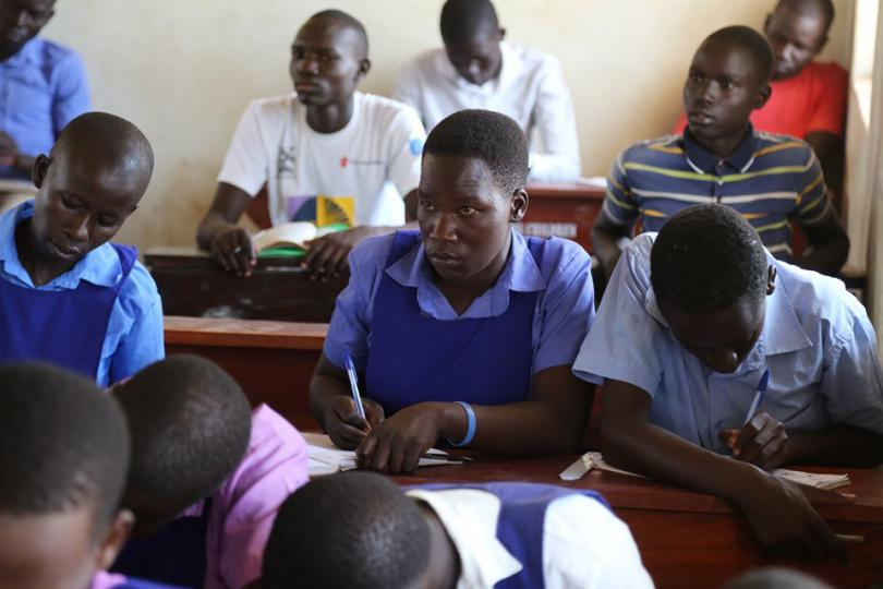 Juliet, centre, back in school at the Accelerated Education Programme. Alun McDonald / Save the Children
