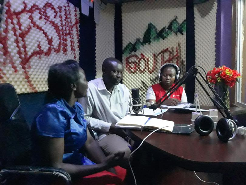 Annet and government officials talk about Ebola at the local radio station