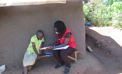 Save the Children staff distribute home learning packs in Kyangwali. Editor Asaba / Save the Children