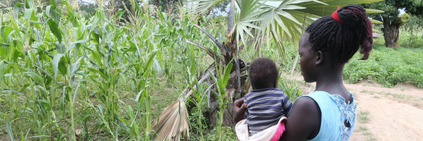 A young teenage mother and child in northern Uganda