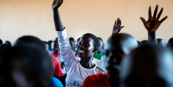 Harriet* at school in a refugee settlement in Uganda. Louis Leeson / Save the Children