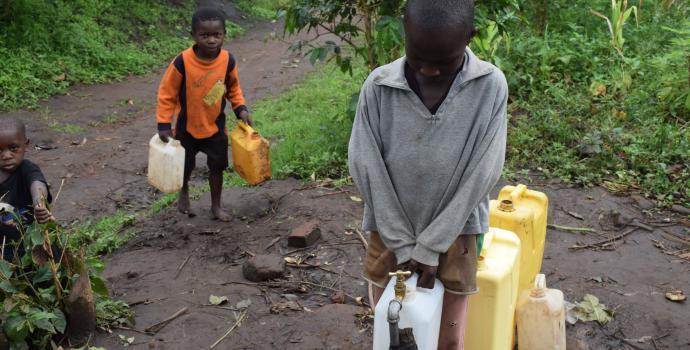 Children in Kyarugomoka collect clean safe water from their new supply