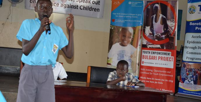 Speakers at the Children's Parliament in Omoro district. Immaculate Nalubyayi / Save the Children