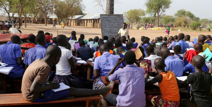 Refugee children in northern Uganda often have to learn outside under trees. Alun McDonald / Save the Children