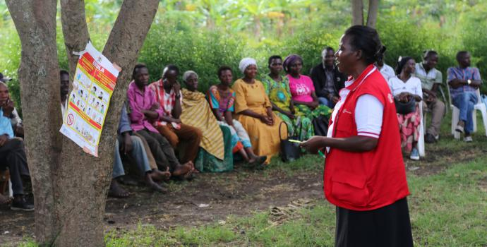 Rose Namugerwa of Save the Children speaks to the community about Ebola. Alun McDonald / Save the Children
