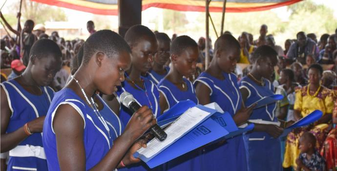 Girls speak against child marriage at the event in Kotido