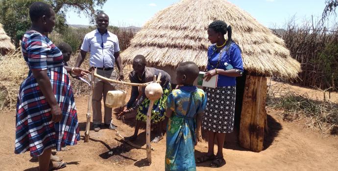 Officials inspect latrines in Lokansenyak village