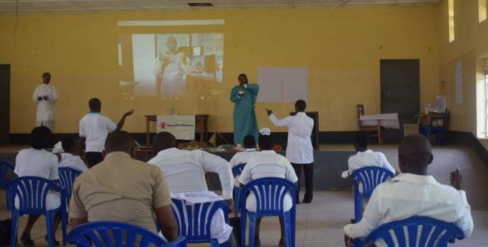 Training health workers in western Uganda on COVID-19. Annet Kabasinguzi / Save the Children