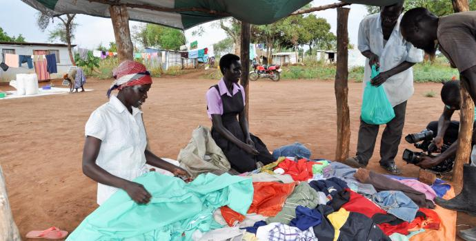 Emma (centre) and her mother at their clothes business